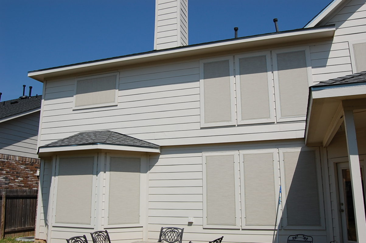 Stucco On Frame : Stucco solar screen installation with champagne frame