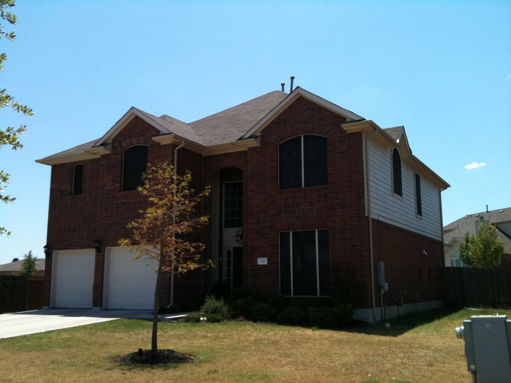 Kyle TX solar screens installation for a home in the Hometown Kyle Subdivision.