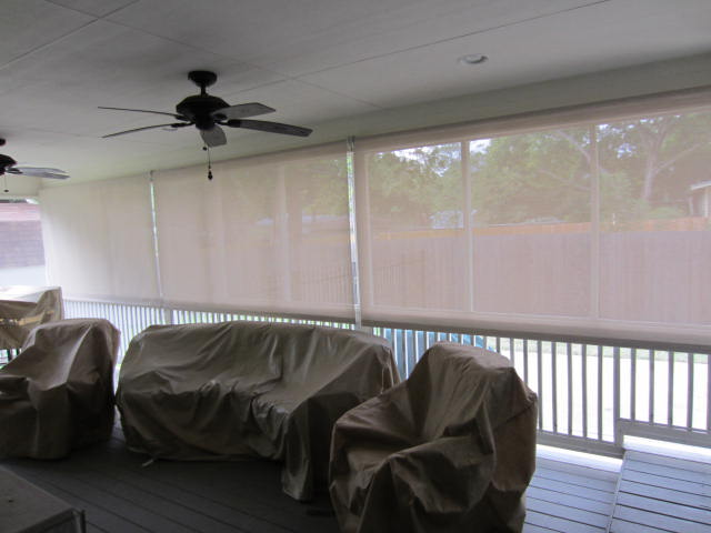 "The installed cost for this exterior patio roller shades Austin TX installation was $933. The installed price of $933 included one measure trip one installation trip and (3) 120"" wide patio roller shade exterior screens."