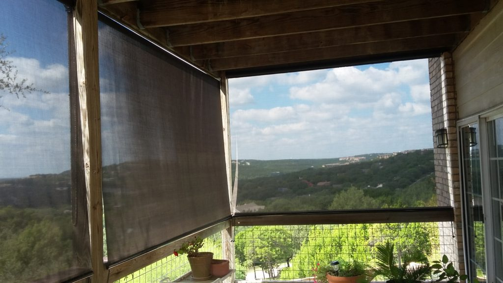 Looking out our chocolate 90% Austin TX exterior patio roller shades.