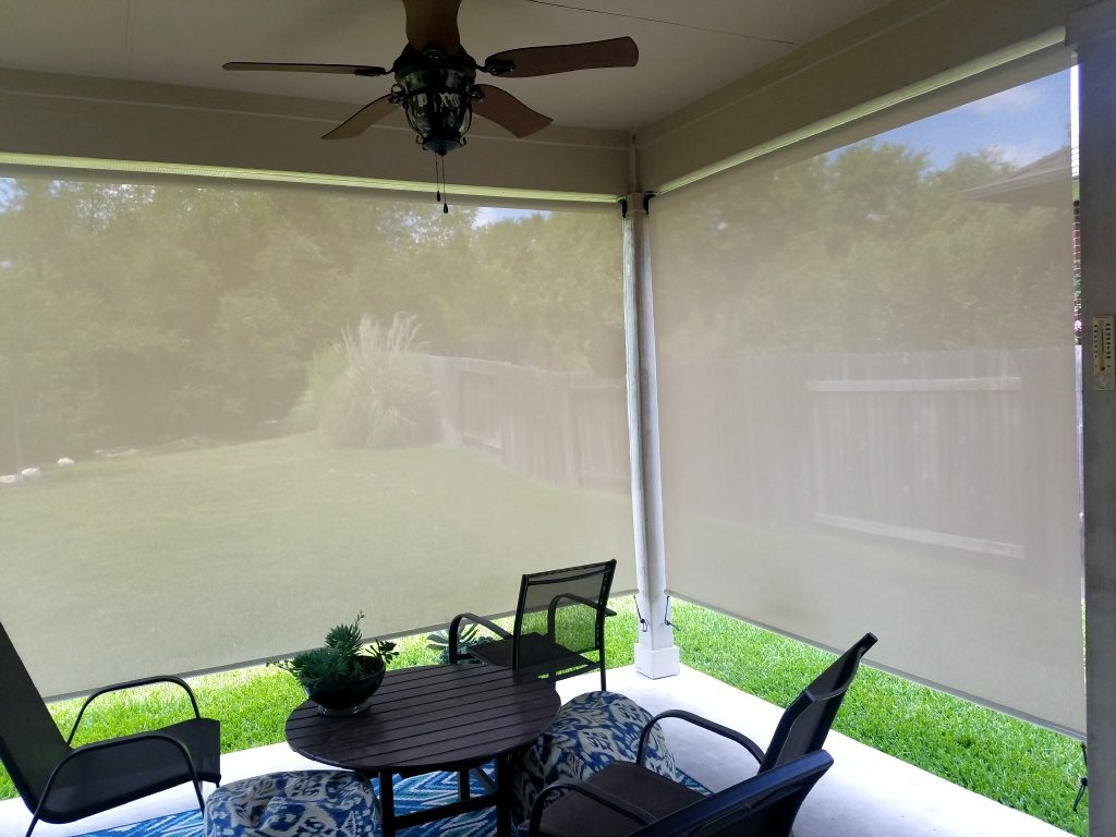 Example of looking out (through) two 97% beige / white fabric porch sun shades.