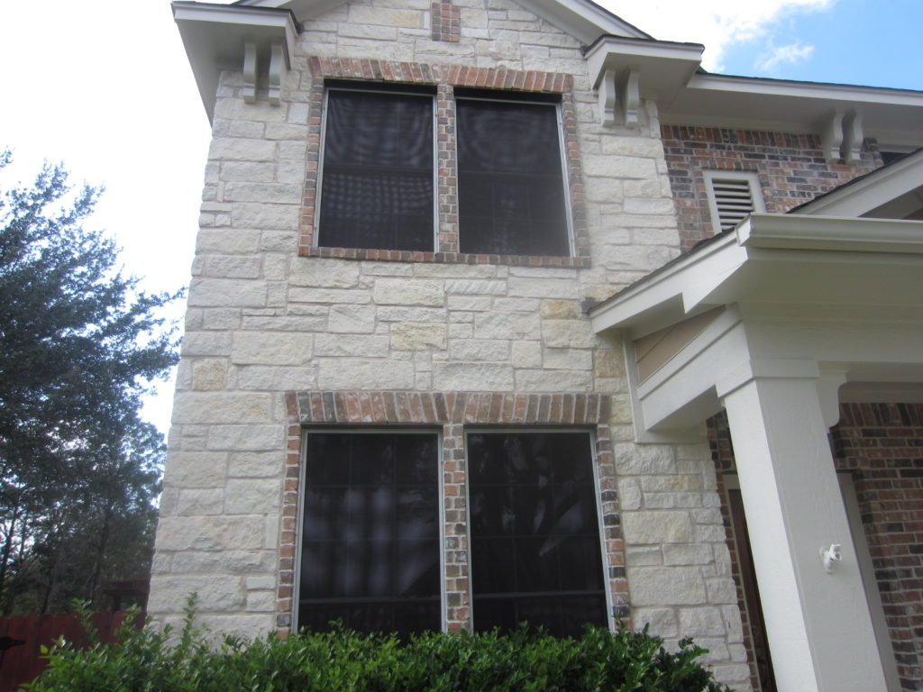 Front of Home showing four 80% solar screens.