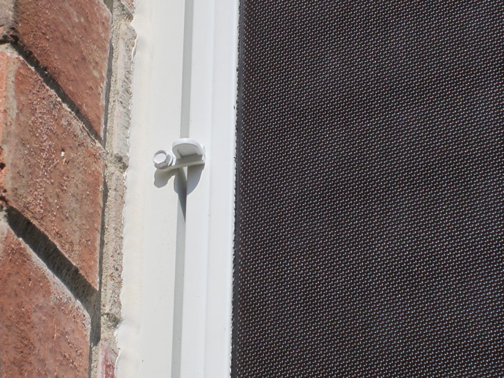 What a flush clip looks like that is put in place to keep a solar screen from coming off on its own.