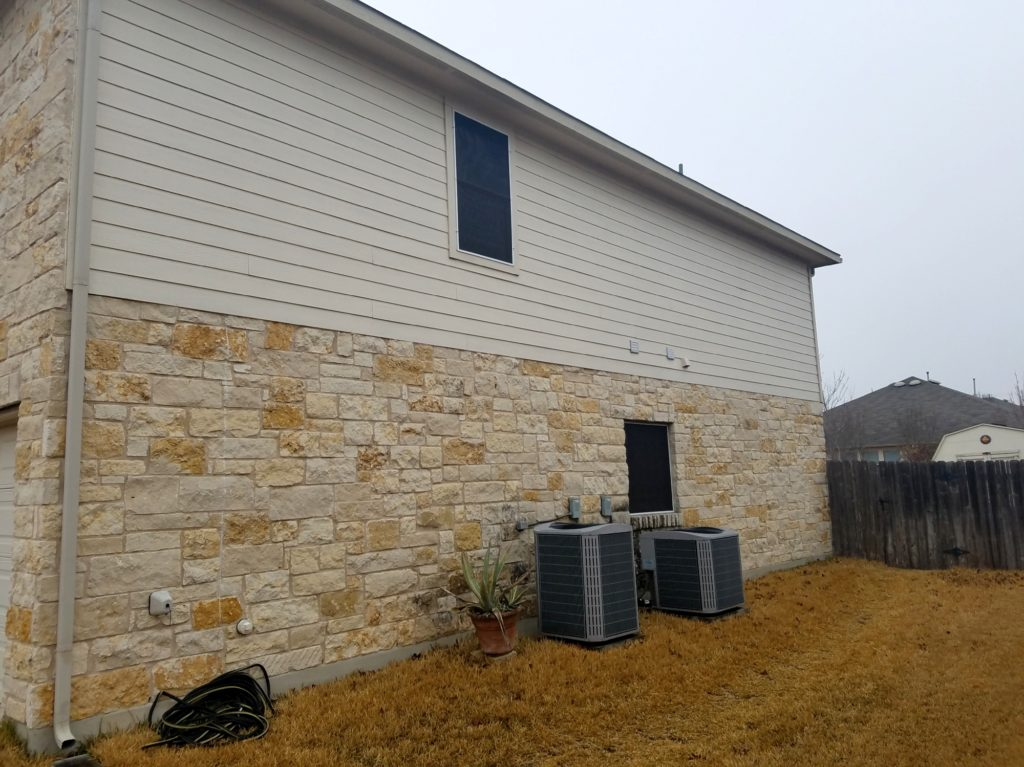 80% Pflugerville Texas solar screens. Showing both solar screens installed over the two windows.