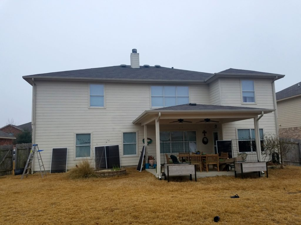 80% solar screens Pflugerville TX installation. Showing back of home prior to installation.