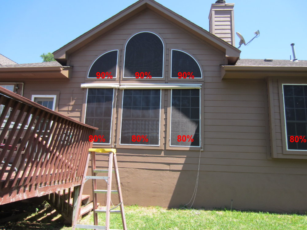 The three upper arched not opening those have 90% solar screens. The windows below them have 80% solar screens.