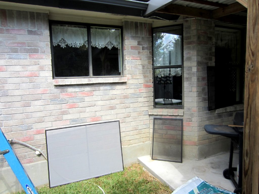 This picture shows a gray fabric solar screen there to the left that covers the entire window. And to the right a small 24 by 30 yet and stick bug with a screen that will fit into just the opening portion of the window. That gray fabric solar screen will fit over the entire window to provide shade for that entire window.