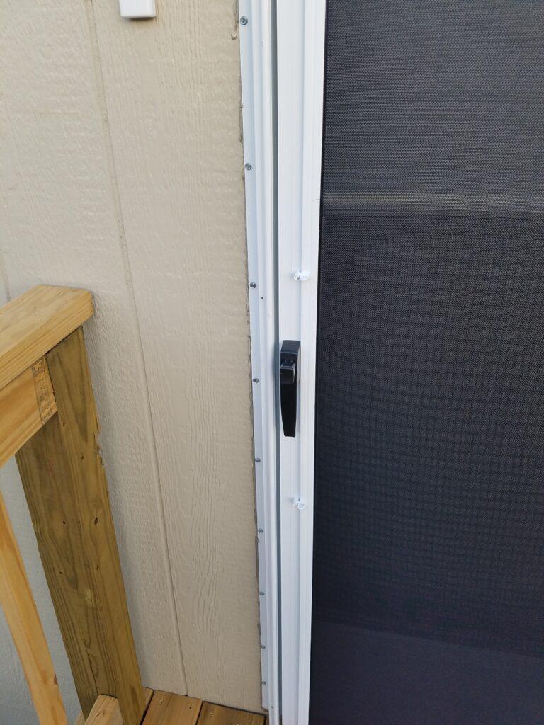 Solar screen on Storm door with turn clips