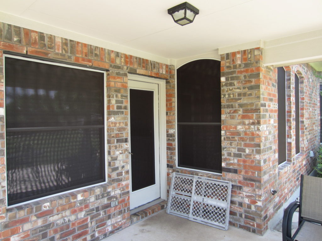 Recessed swing patio door that is covered by a patio roof. For consistency, the homeowner chose to put a solar screen on this patio door.