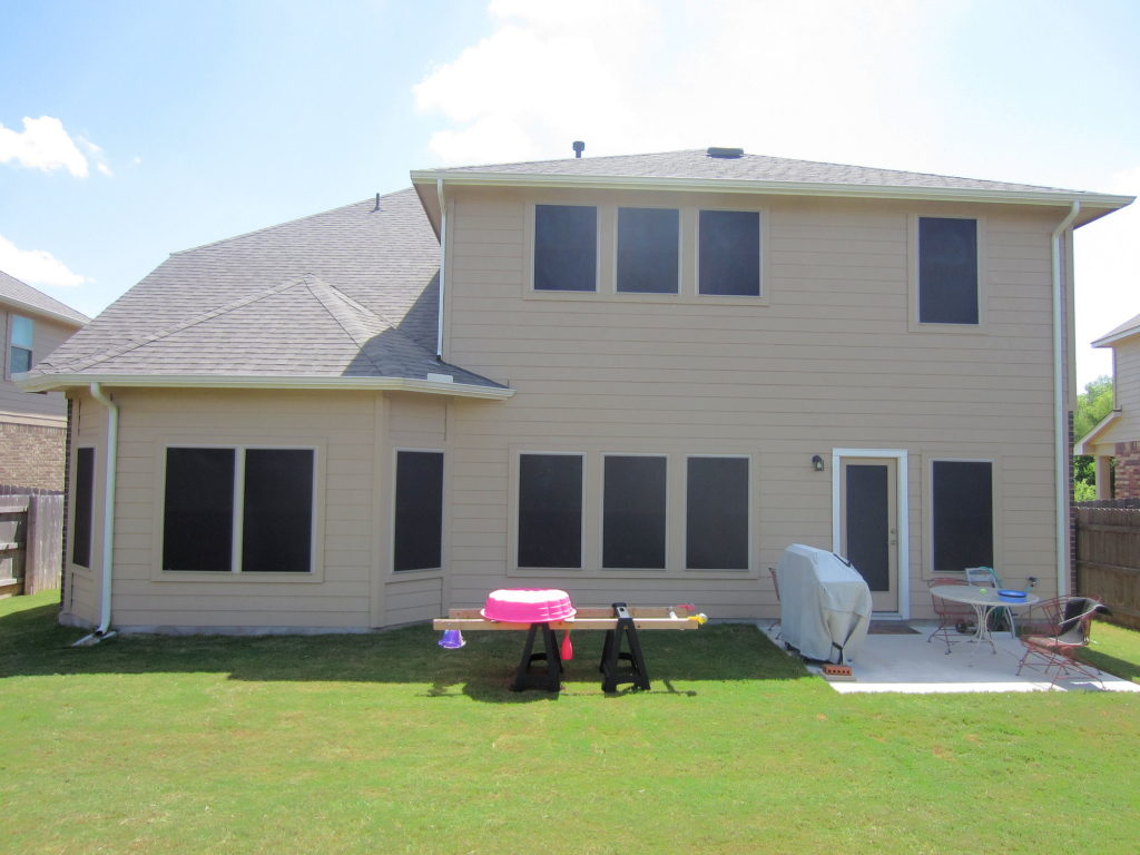 This is the west facing side of the home. We used our 90% solar screens here. We put a 90% solar screen on that back patio swing door. There's no kind of Awning or shade to protect that door. That door gets blasted by the Sun. Now the inside of that door is shaded by one of our 90% solar screens.