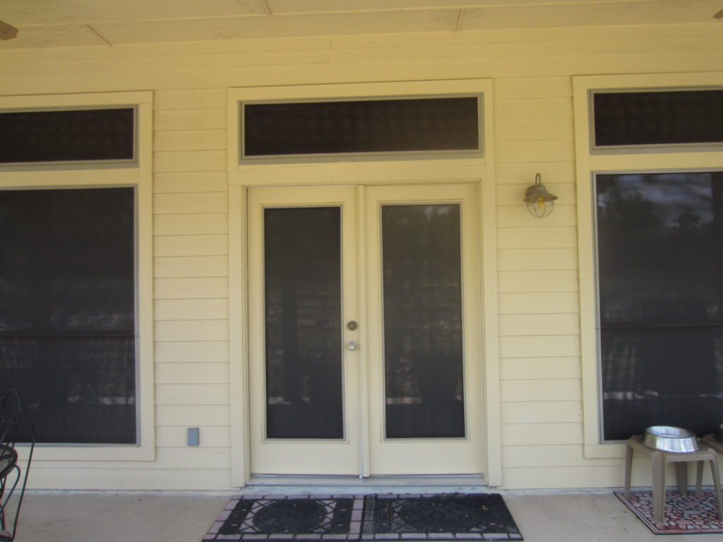 French doors with solar screens. Double swing doors with solar screens.