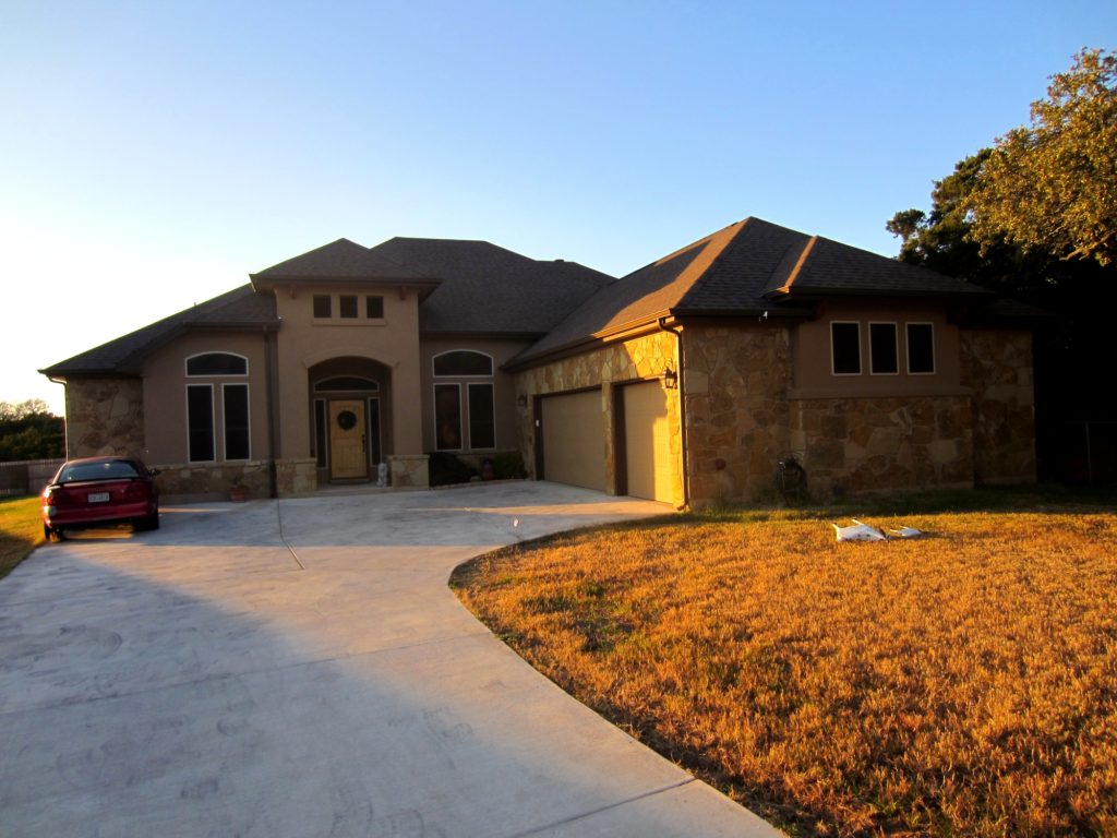 13 installed 80% Liberty Hill TX solar screens. This is the front side of this home.