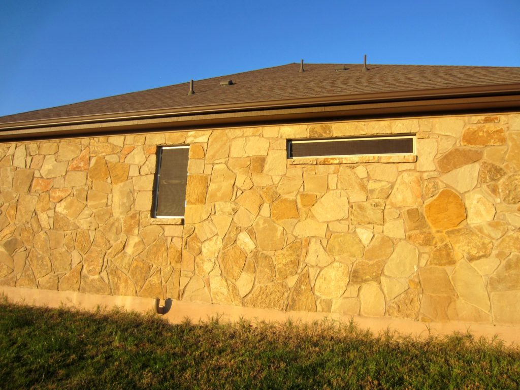 Left, West facing side of the home. Two 90% solar screens Liberty Hill TX were used here for this Hot side of the home.