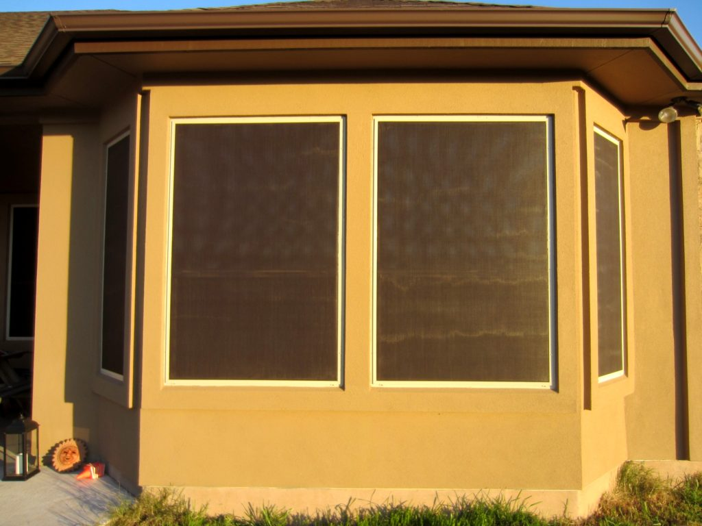 90% solar screens Liberty Hill Texas closeup picture showing four 90% screens on a bay window.