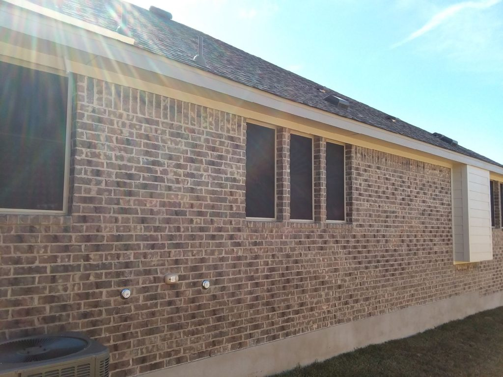 90% solar screens Leander Texas installation. The right side of the home where we installed 7 90% solar window screens.