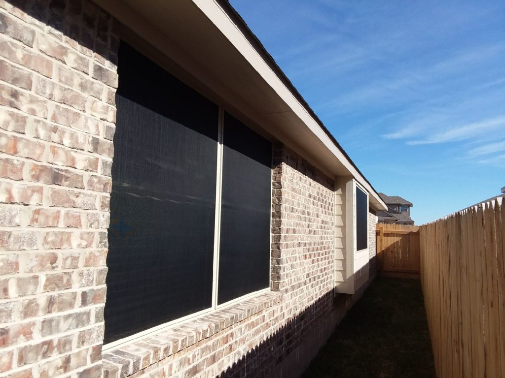 90% Leander Texas solar screens. The left side of home showing 3 of the 7 installed 90% solar window screens.