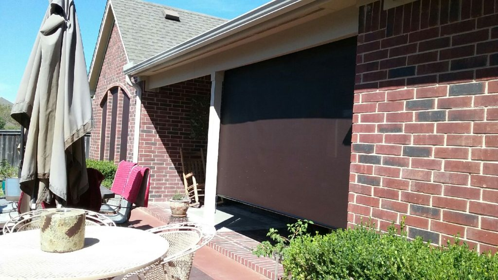 Exterior Patio Roll Shade, installed in Manor TX. Showing one roll shade in the down position.