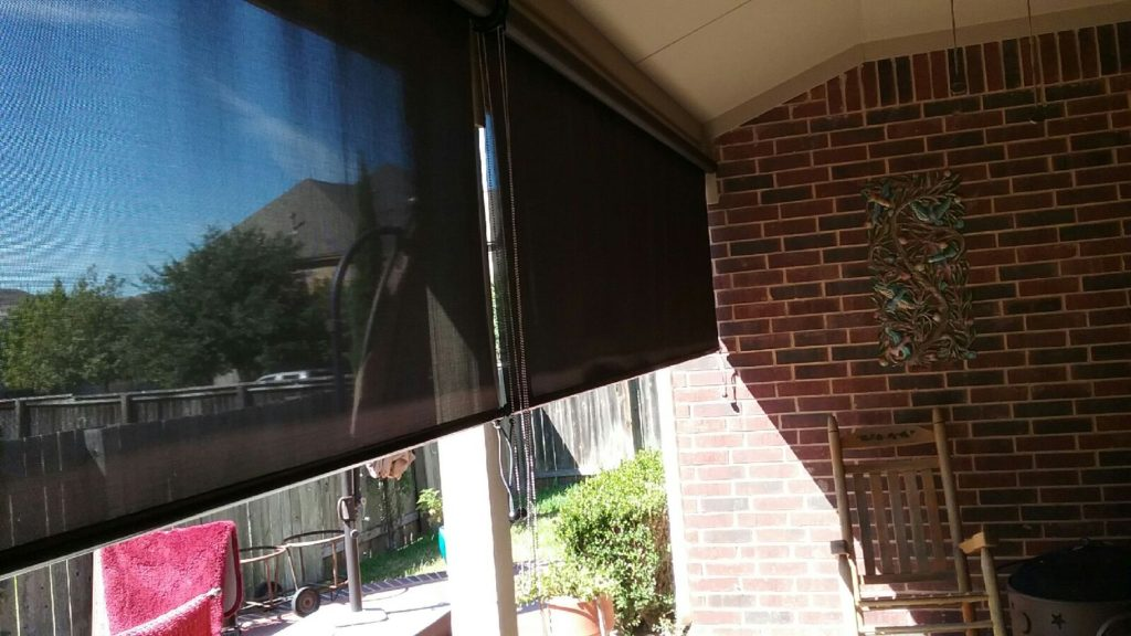 Notice the shade on the wall that these 90% exterior patio solar screen roll shade are providing. That's 90% shade.