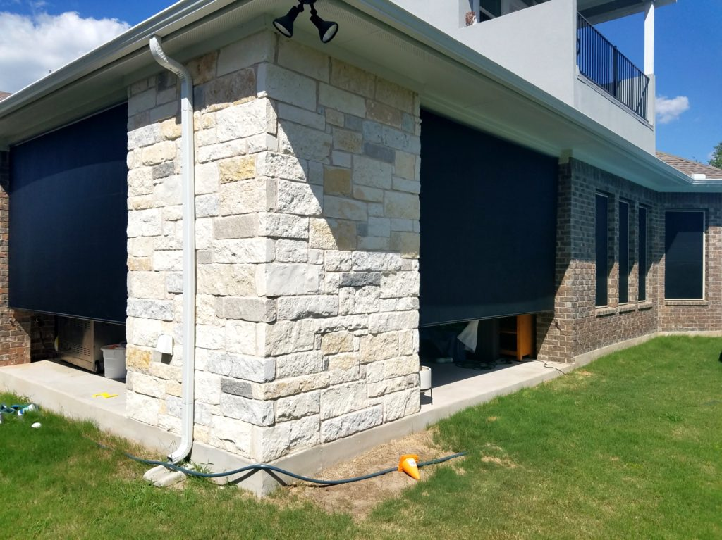Two black 90% outdoor patio shades. Shading this Georgetown Texas patio.