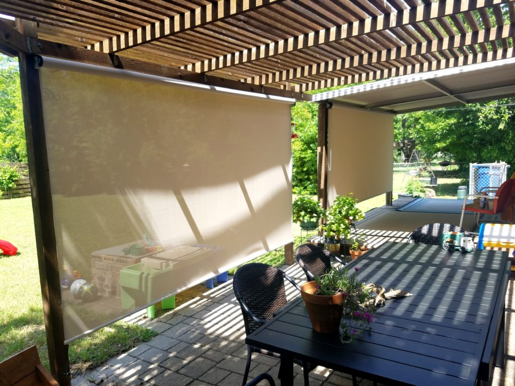 "The installed cost for these two porch shades was $722. The installed price of $722 included one measure trip, one installation trip, sales-tax and (2) 106"" wide exterior patio porch shades. 97% beige fabric."