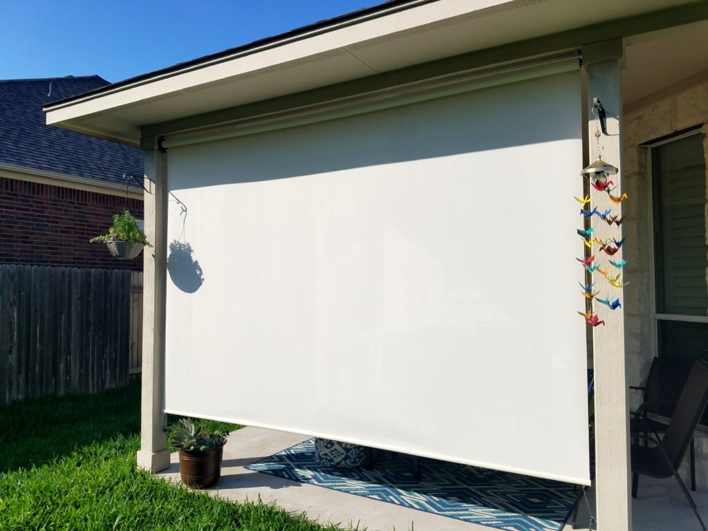 Outdoor roll up blind we made using our 97% Beige / White Fabric.